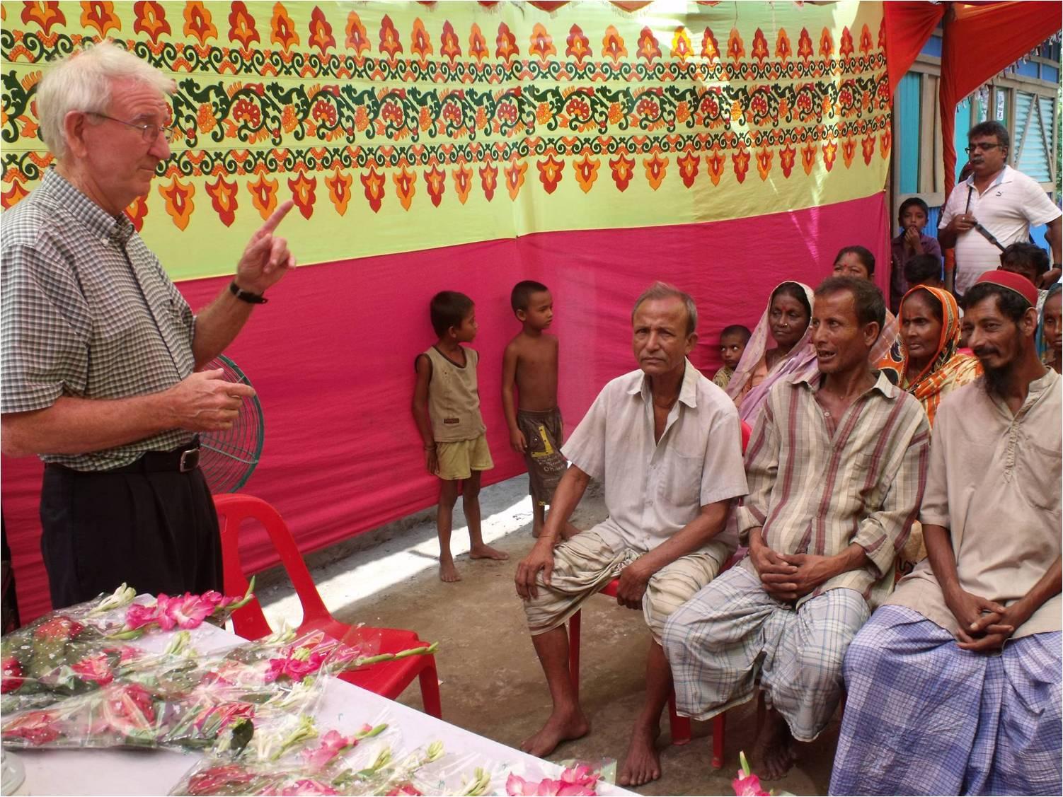 Harold preaching to village people
