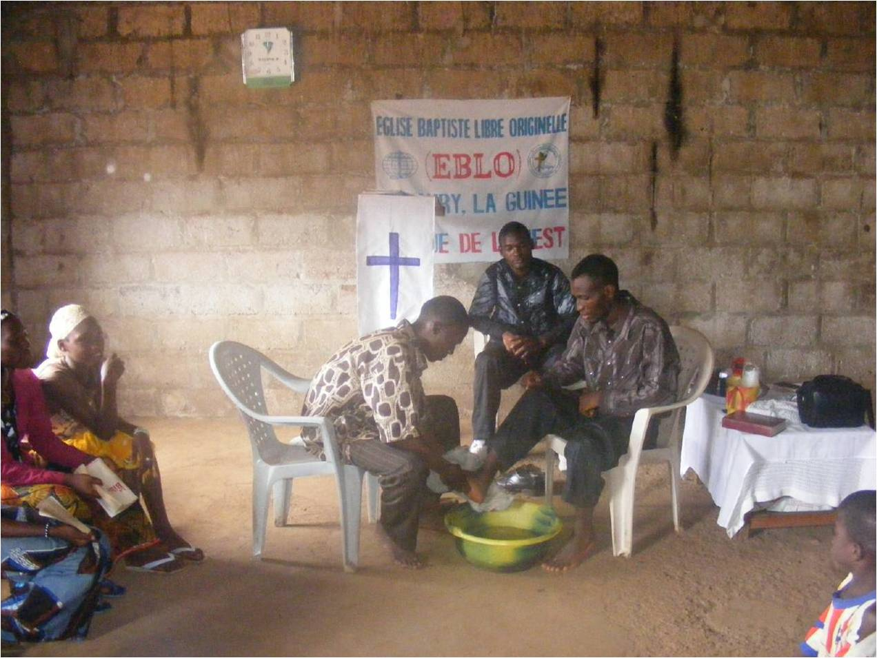 Feet washing service in Guinea