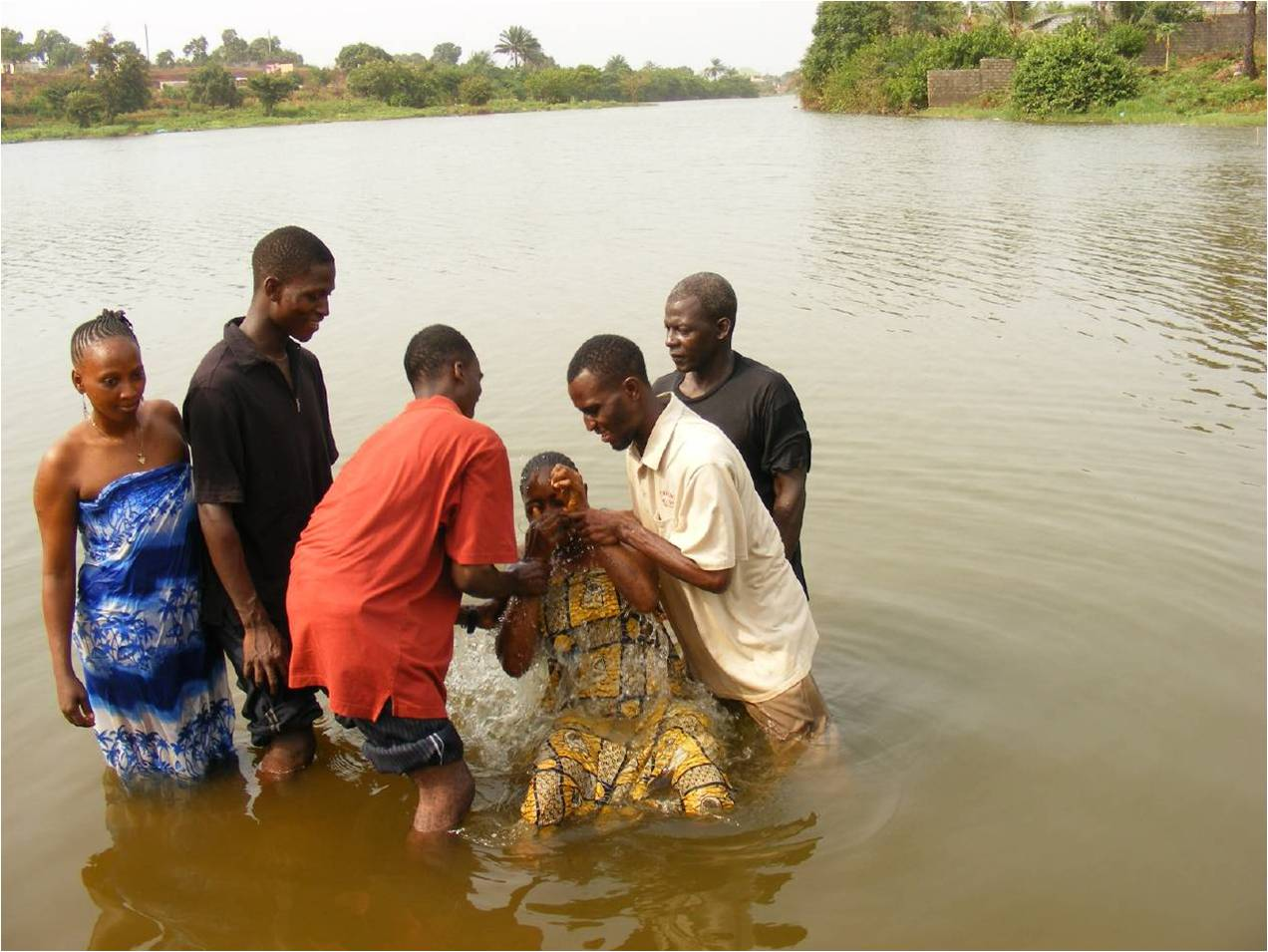 Baptizing in Guinea